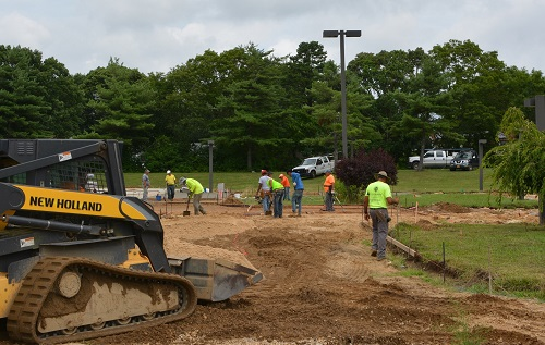 Town Crews work beside the reconstructed Roberto Clemente Pool