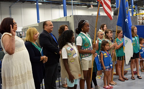 Supervisor Carpenter Stands for the Girl Scout Color Guard at East West Industries
