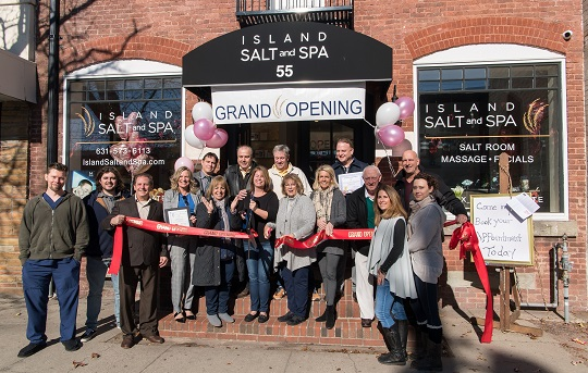 Island Salt and Spa Owners and Staff along with Sayvile Chamber, Islip Supervisor Angie Carpenter and Councilwoman Mullen pose with ribbon and scissors infront of the new storefront